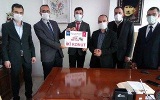Erzurum'daki din görevlileri konut bağışladı