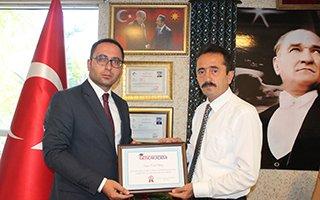 Cemal Almaz'a Başarı Belgesi Verildi